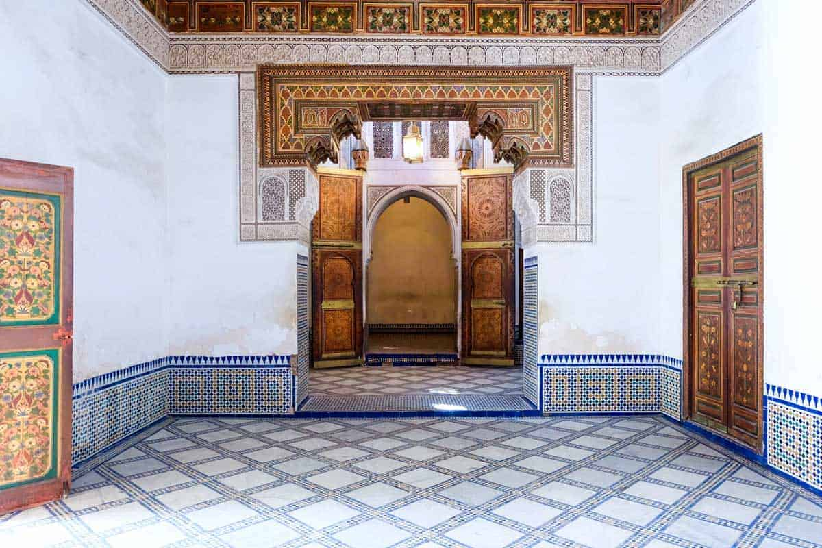 The interior of the opulent Bahia Palace with intricate tiles and wood carvings. One of the most important tourist attractions in Marrakech