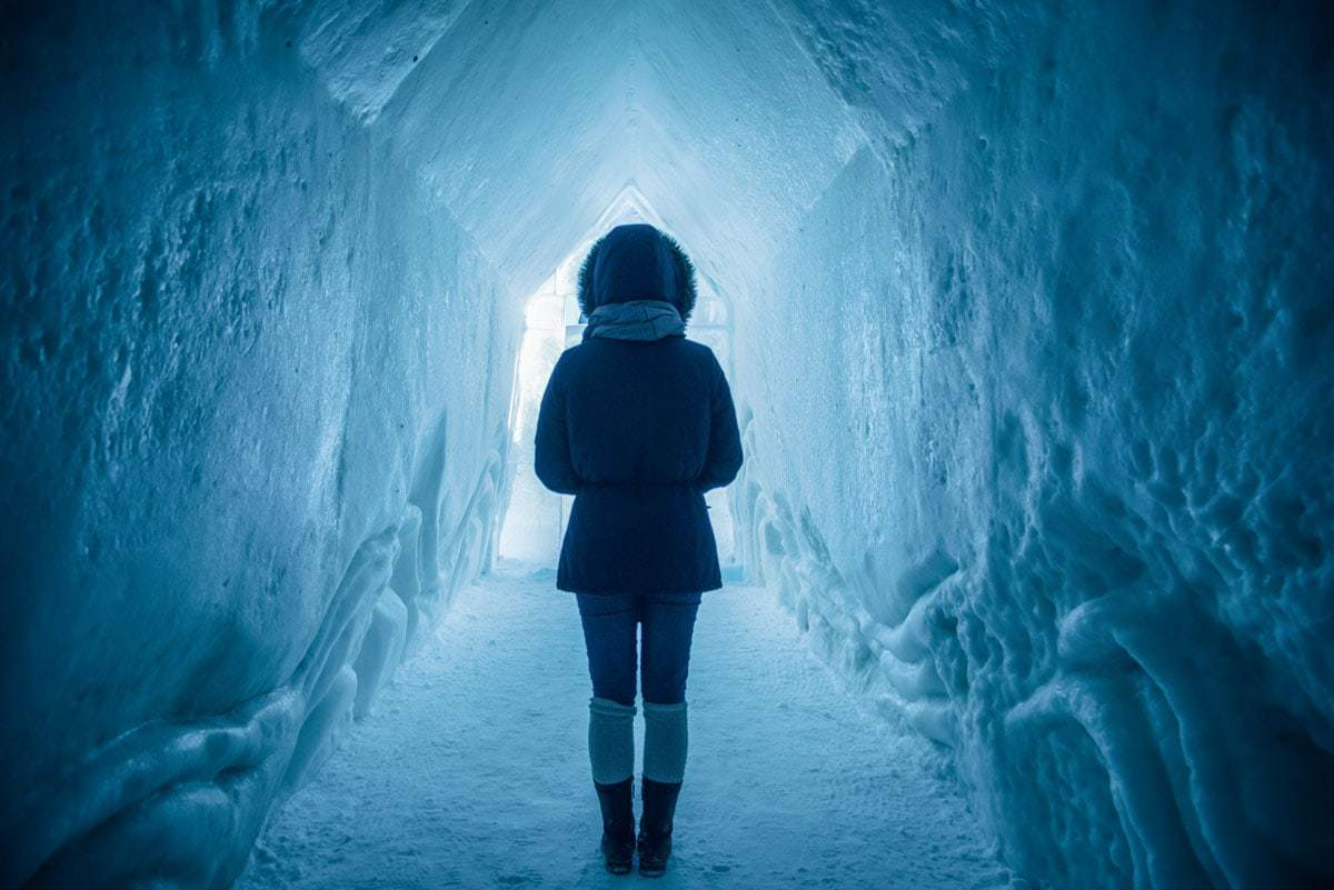 Girl standing in the Langjökull ice tunnel in Iceland in winter