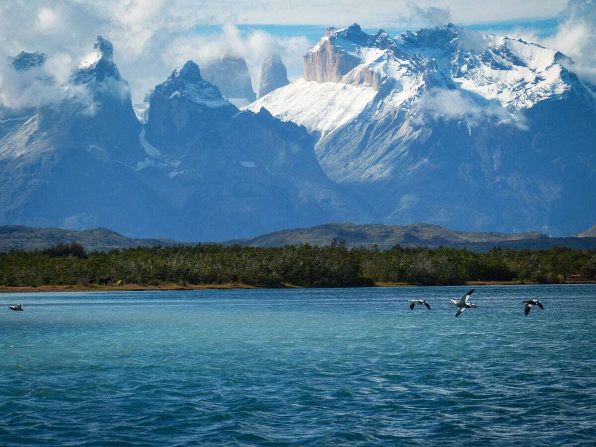 Rugged snowy mountains and choppy water in Patagonia