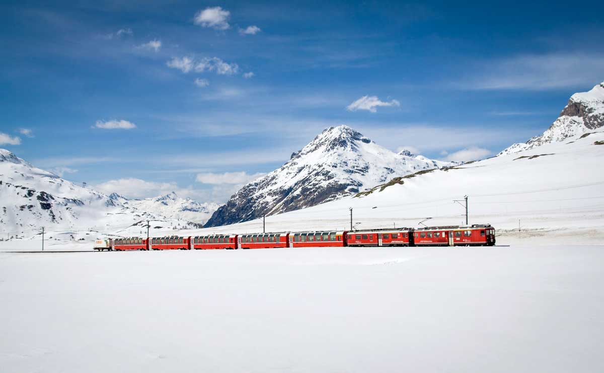 A scenic train ride through the Swiss Alps is beautiful any time of year but especially in winter.