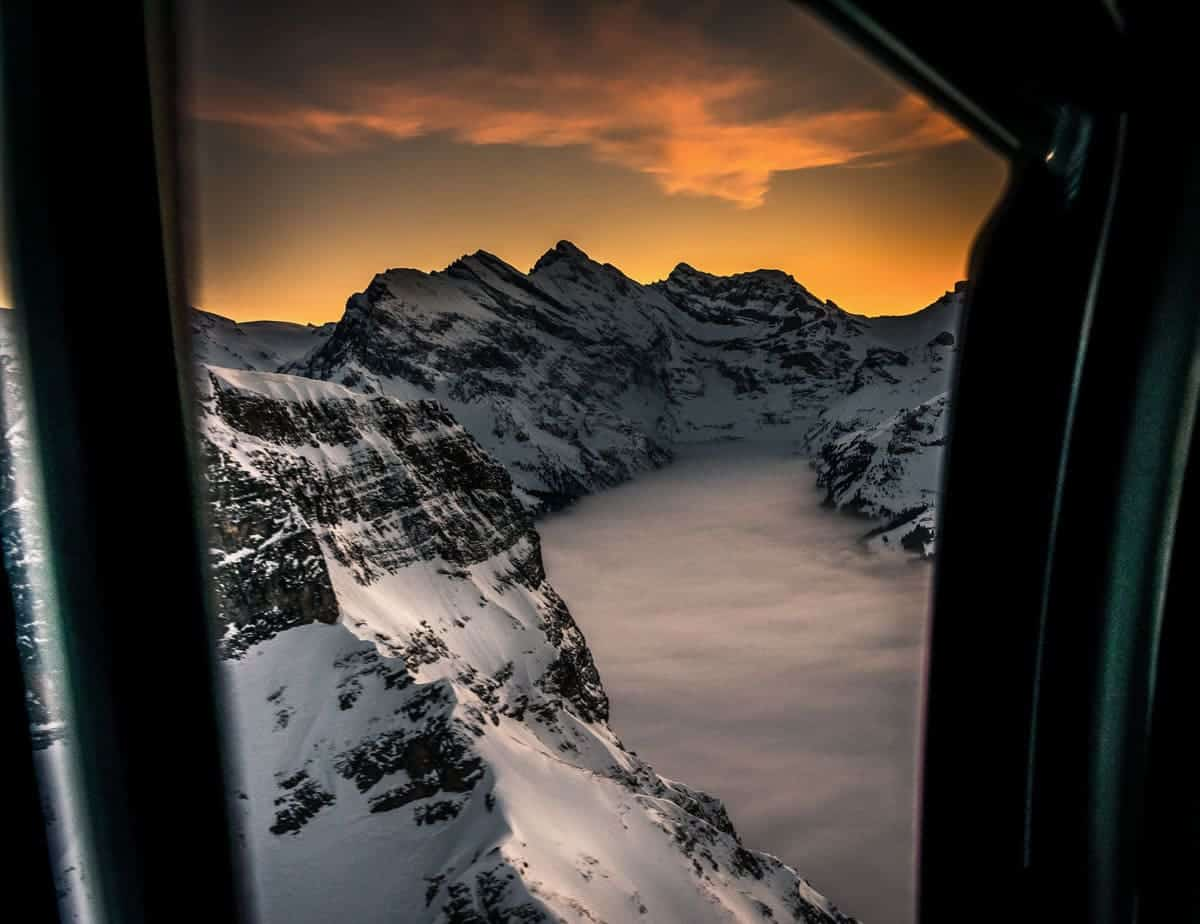 Taking a helicopter flight over the Swiss Alps in winter