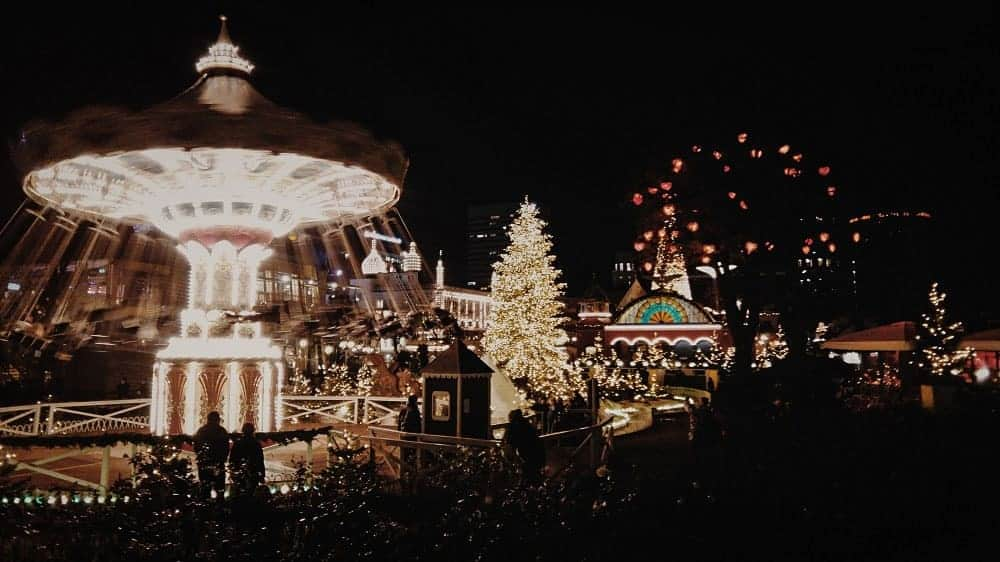 Tivoli Gardens in Copenhagen light up with Christmas lights at night. What to do in Europe in Winter