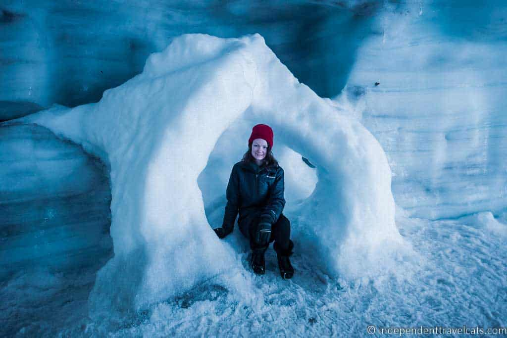 Girl sitting in the Langjökull ice tunnel in Iceland in winter
