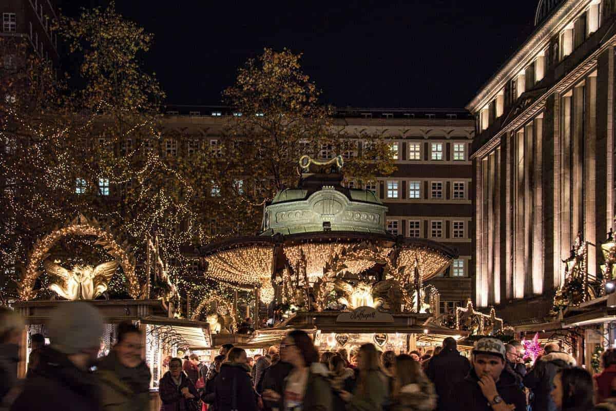 Dusseldorf Christmas market crowd and merry go round.