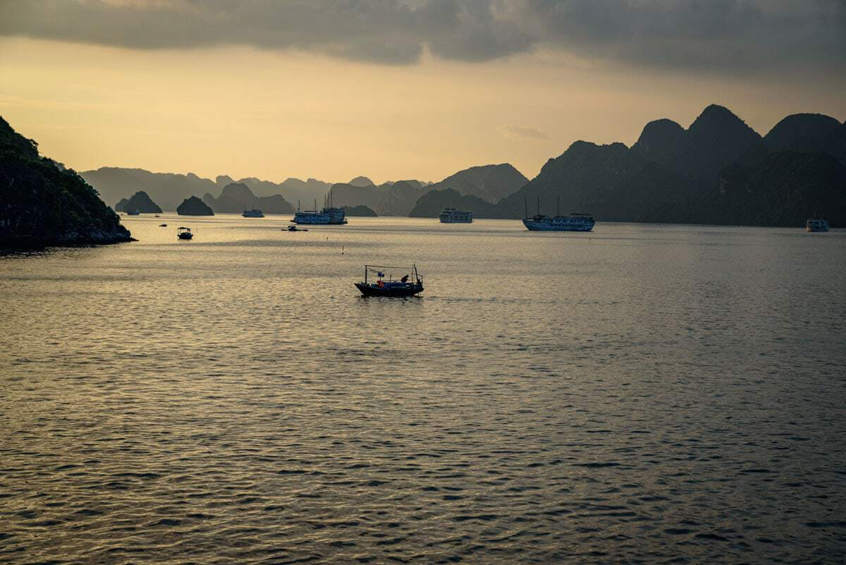 Sunset over Halong Bay is beautiful on a winter cruise