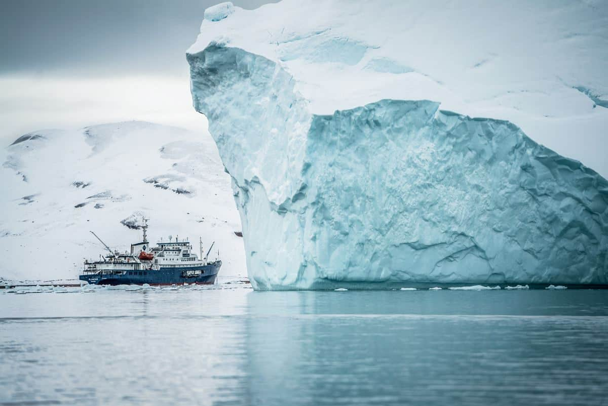 Sailing under icebergs in Greenland, the best winter cruise experience in the world.
