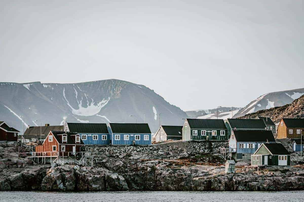 Local village houses in Greenland during a port of call on Greenland cruises