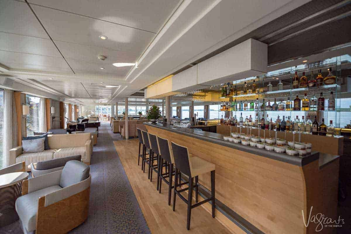 The bar on a viking river cruise. The bar is lines with fancy glasses and high end booze. How should you dress for a viking cruise. Smart casual is the answer, remember you are on holiday and want to look good and be comfortable.