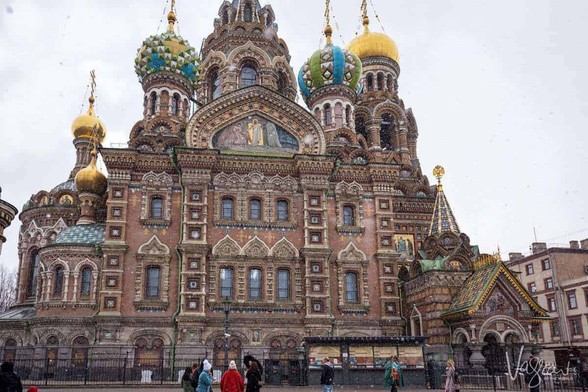 Colourful cathedral in St Petersburg with light snow falling. You may ask what should I pack for a european river cruise. The cruise packing tip here is to always be prepared for changes in the weather. You never know when it may snow.