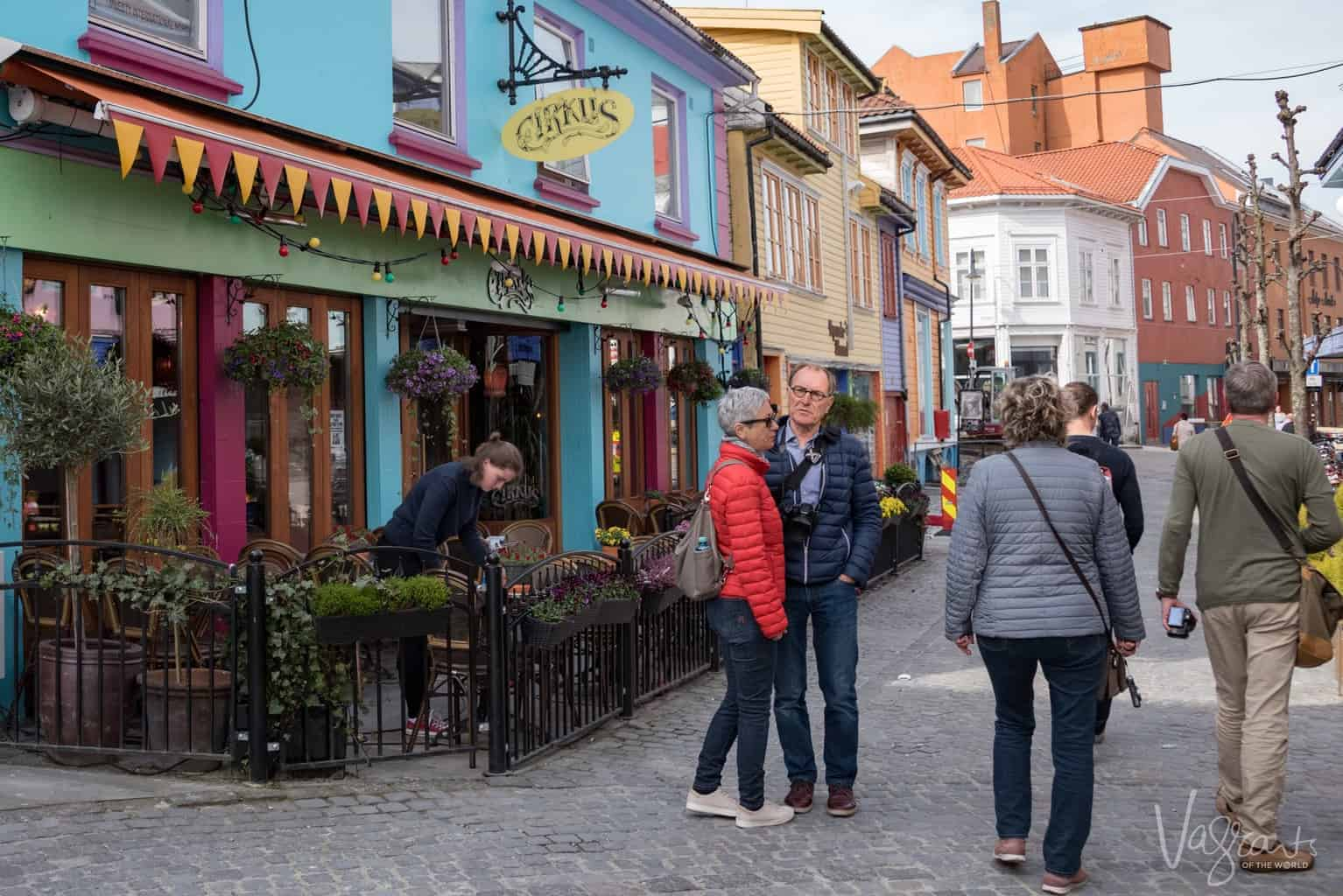 Viking river cruise packing list and cruise packing tips. Smart casual dress is best for day wear on a cruise. Just make sure your clothing and footwear are comfortable like these people on a cruise excursion in Norway.