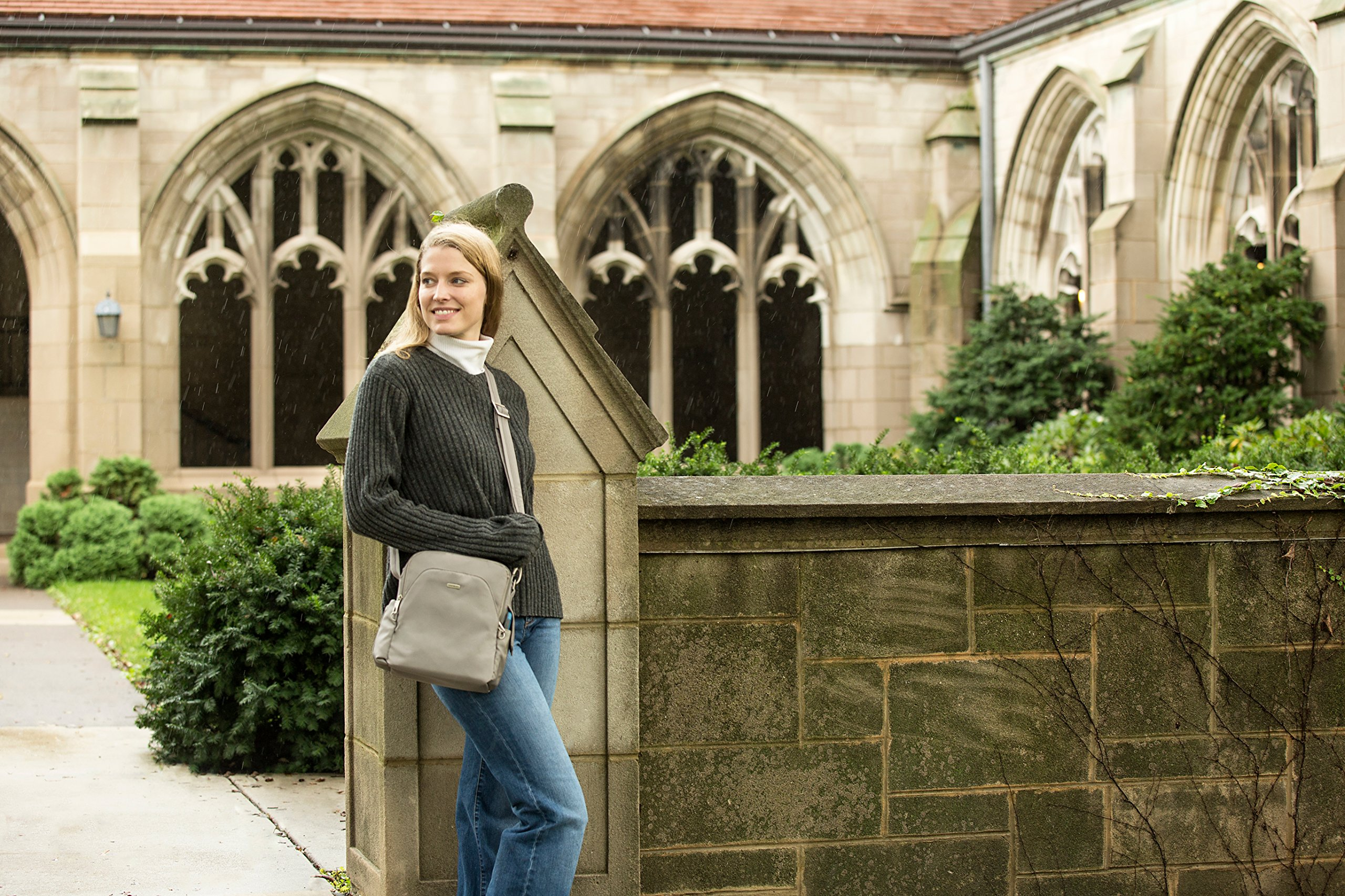 Girl with a secure travel bag .outside a church. An rfid bag is also essential when travelling