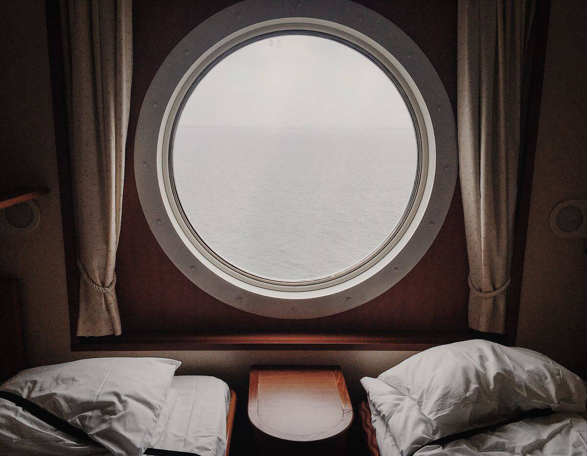 View of porthole in a ship cabin. Remember cabin safety to stay safe on a cruise. Keep your door locked at all times.