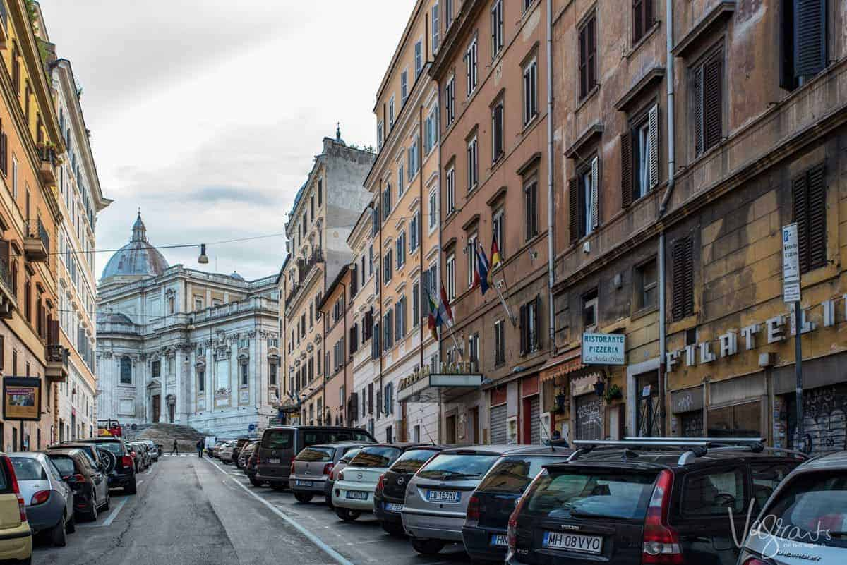 Cars parked along Rome's famous shopping street.