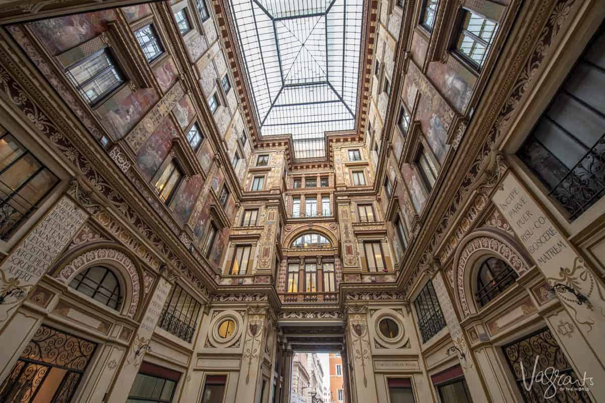 Stained glass and facades inside Galleria Sciarra.