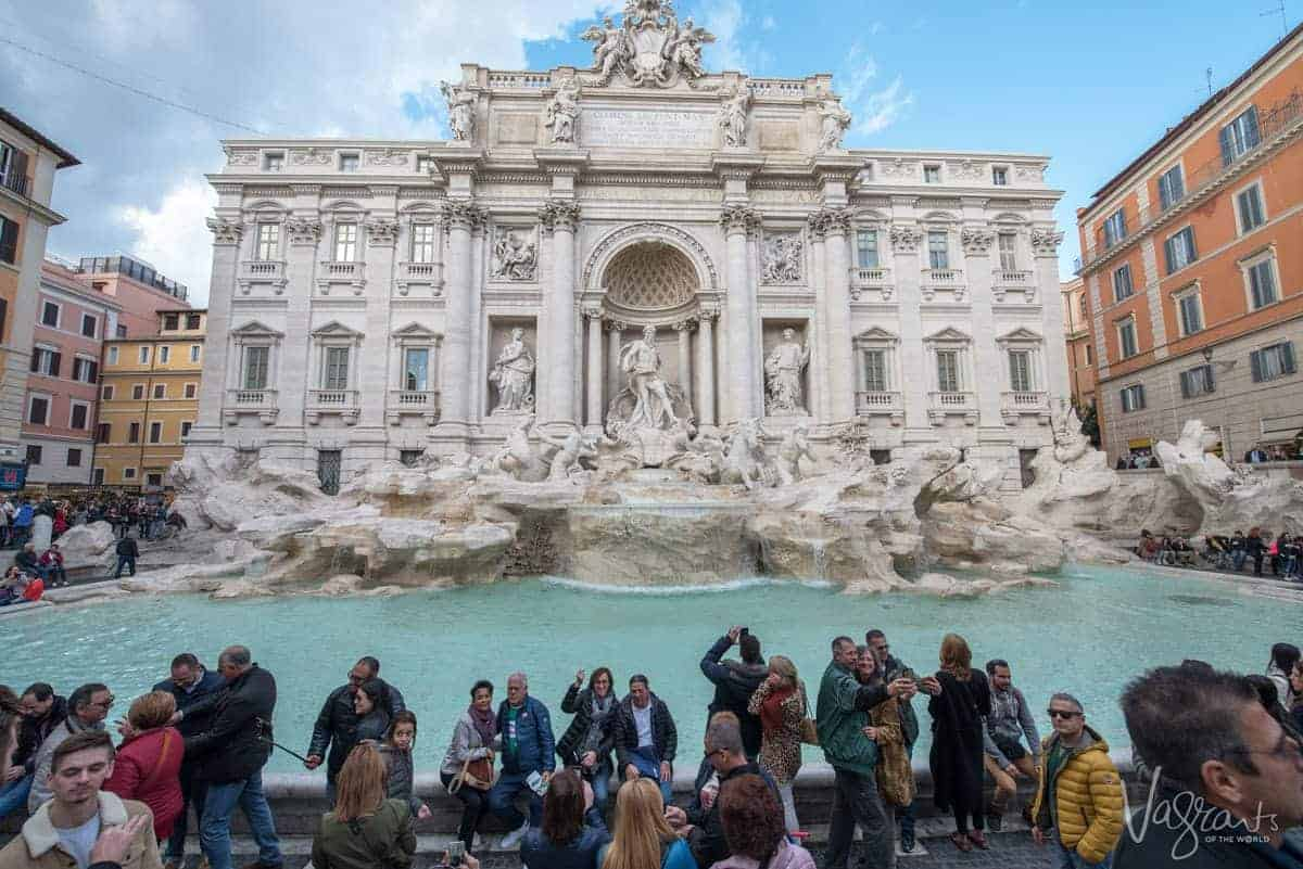Hundreds of tourists vying for photos at Trevi Fountain.