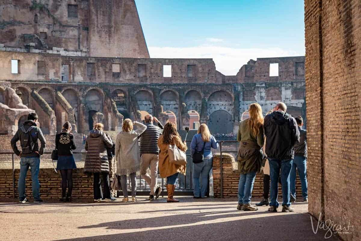 People standing looking over the Colosseum.