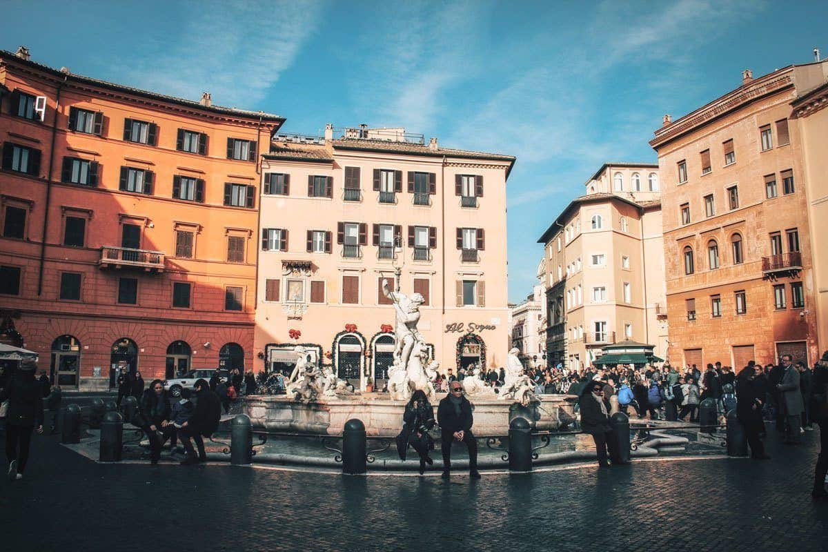 People in front of Fountain of Neptune in Piazza Navona.