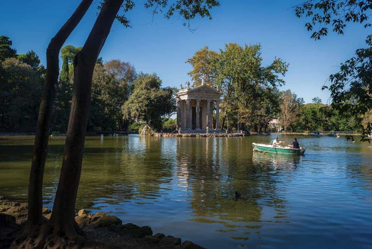 People rowing a boat to Villa Borghese, Vatican gardens.