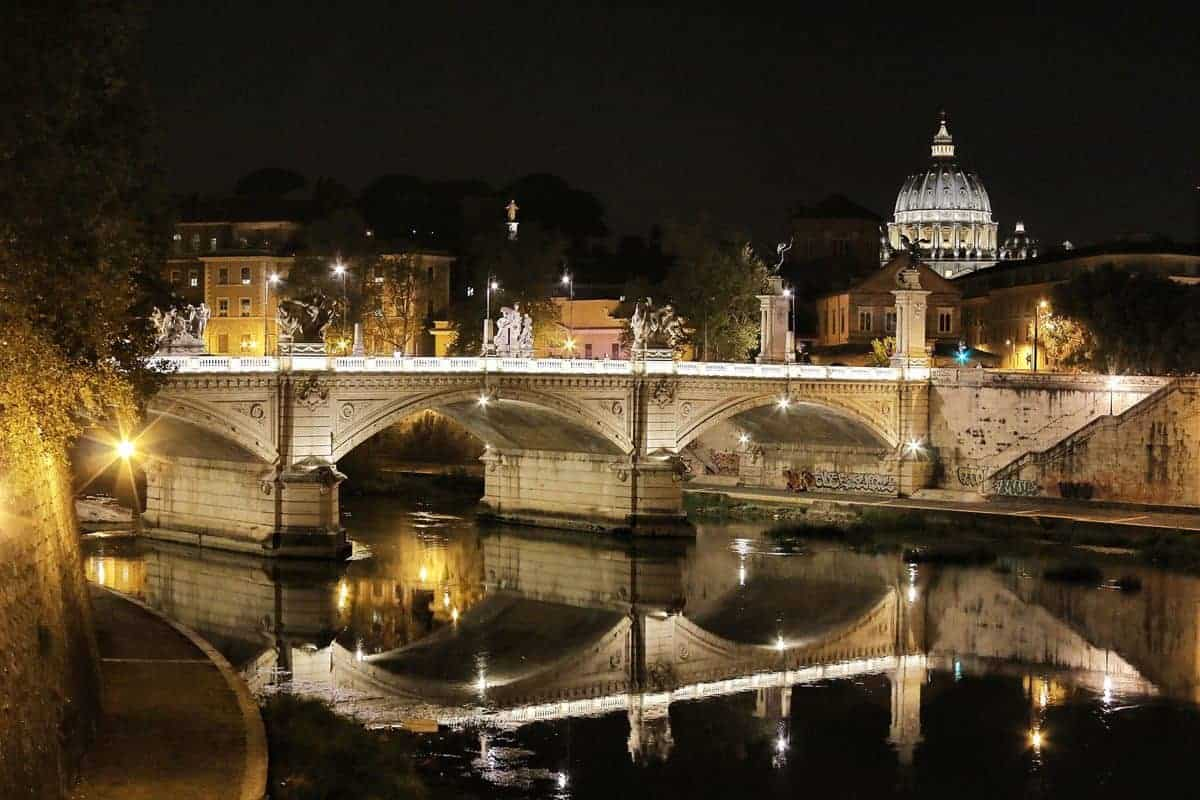 Bridge reflection at night in Trastevere neighbourhood, Rome.