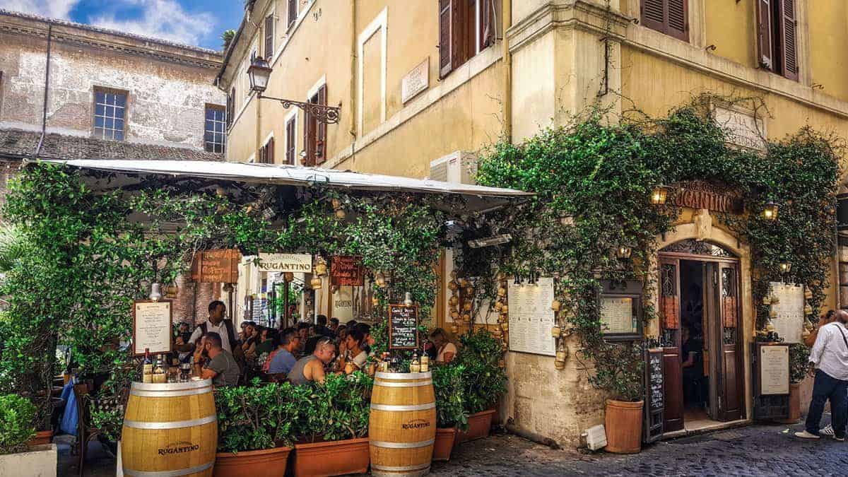Wine cask and restaurant loaded with people and lovely garden in Trastevere neighbourhood.