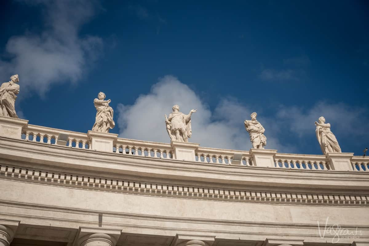 4 marble statues of apostles atop the Vatican.