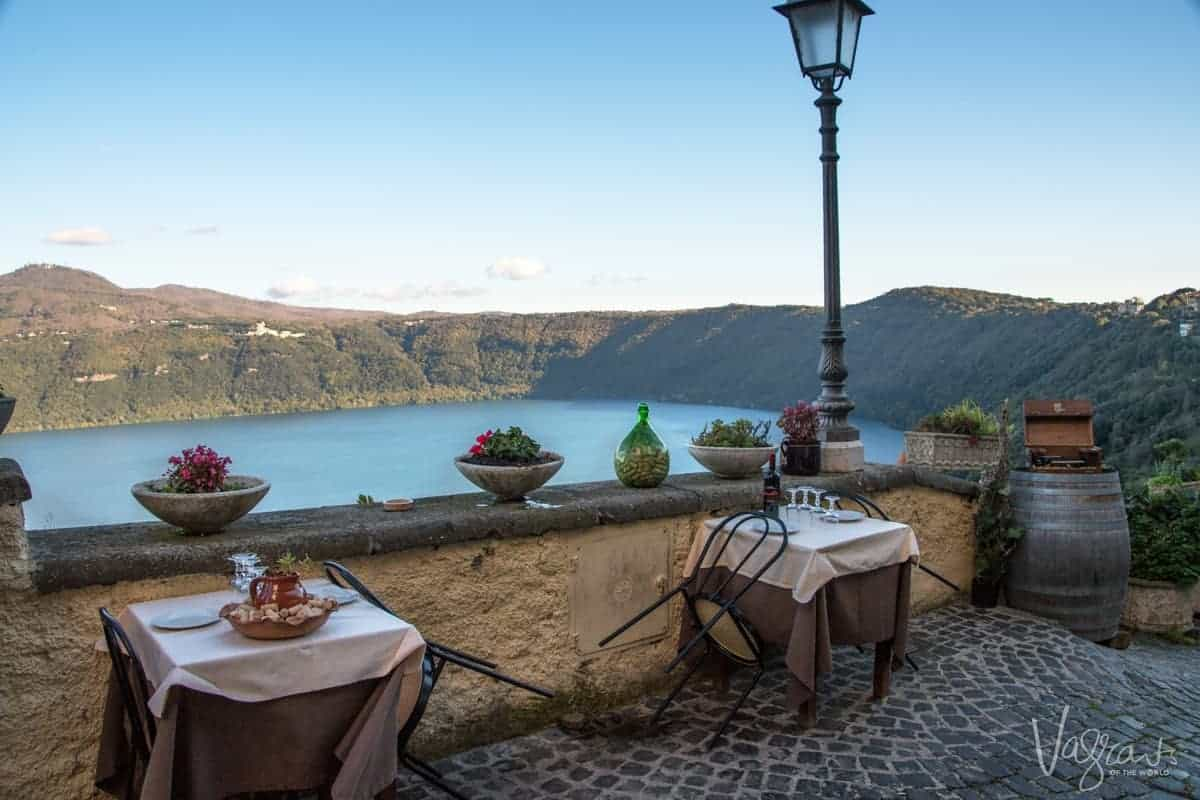 Seating at outdoor table with baskets of bread overlooking the water at Castel Gandolfo