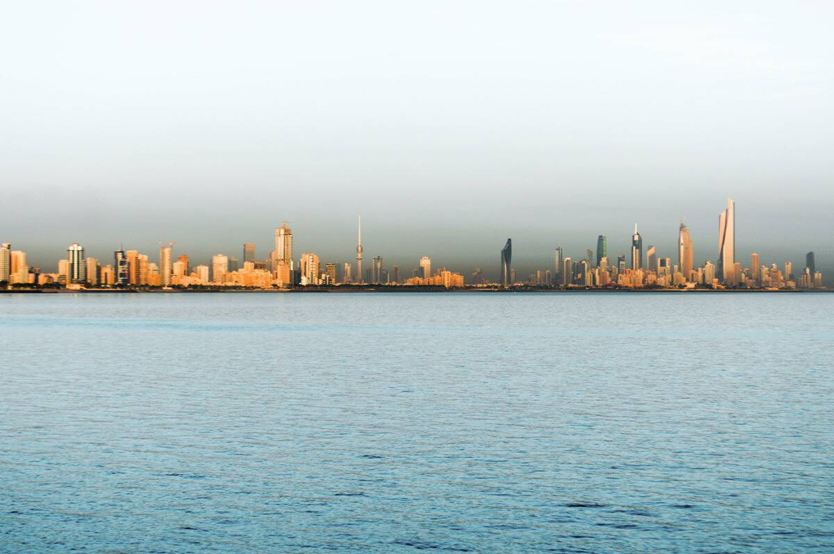 Across the water with the Kuwait skyline.