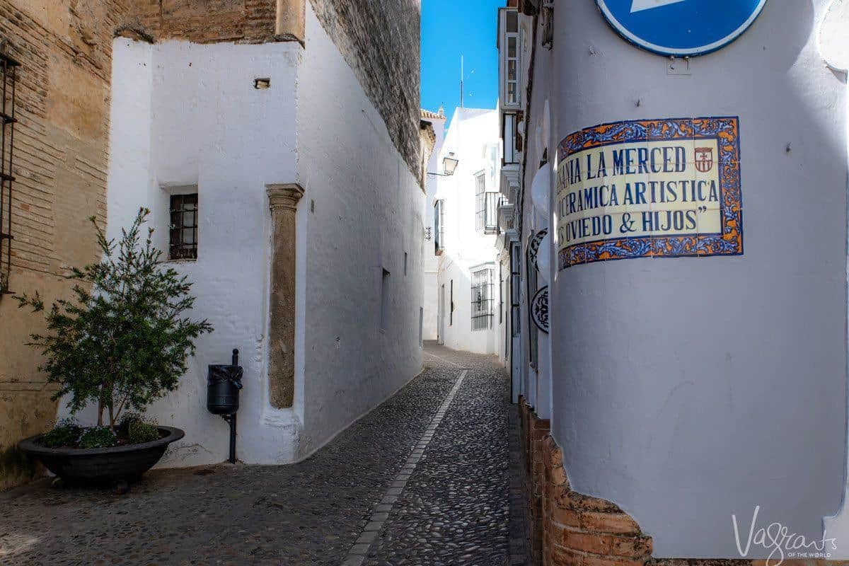 Street corner in Seville with mosaic tiled name plaque, the starting point of the best southern Spain self guided tour