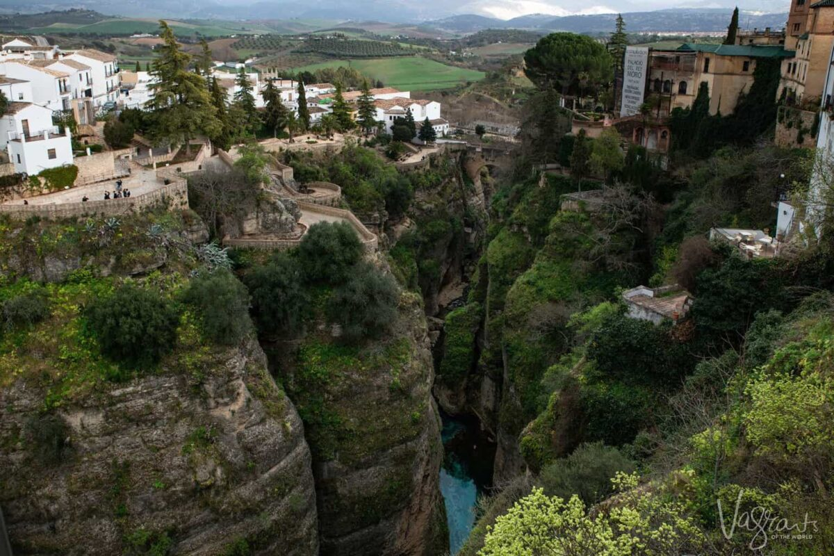 Deep rocky and green gorge of Ronda the largest white village in Spain