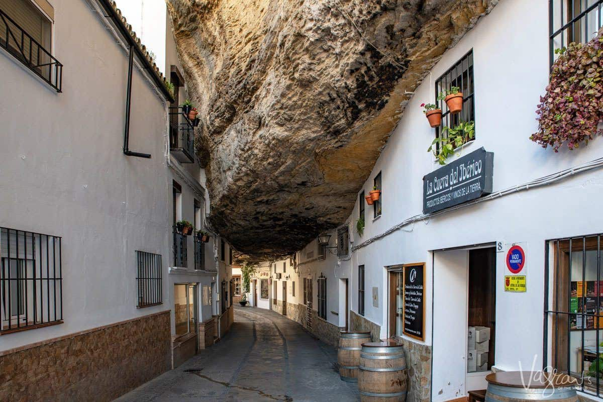 Giant rock hanging down between the two sides of the street in Setenil de las Bodegas.