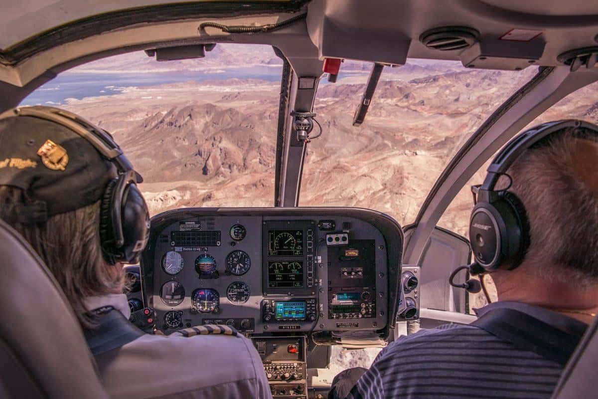 helicopter pilots flying through the grand canyon. a great thing to do in the grand canyon when you visit in summer