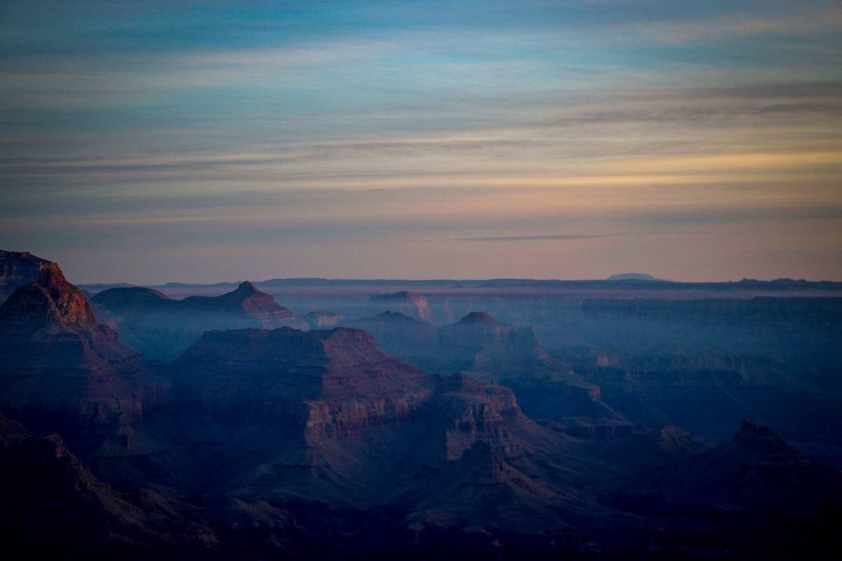 misty cloudy sky above grand canyon. watch out as it is busiest in summer which is the best time to visit the grand canyon