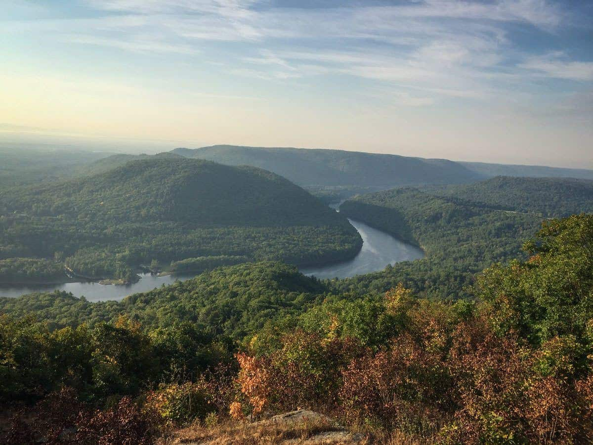 view down into the hudson river valley green trees and winding river, the hudson river valley is a must see destination in usa this summer