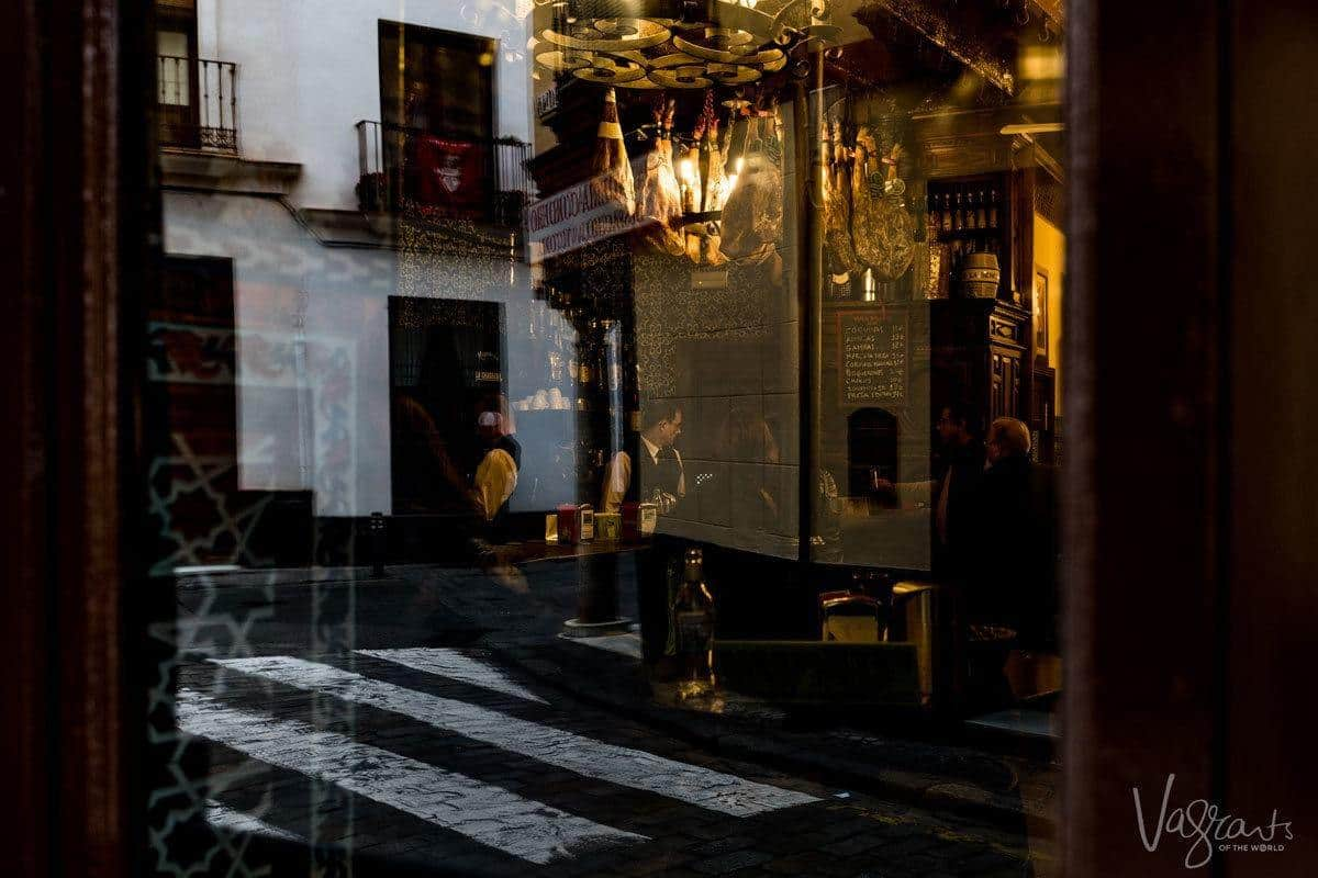 Sneaking look at the waiters through the window of El Rinconcillo - the oldest bar in Seville.