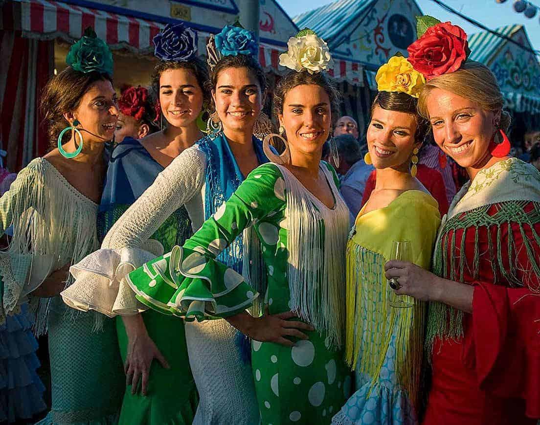 Six flamenco dancers in traje de flamenca the traditional flamenco dress.