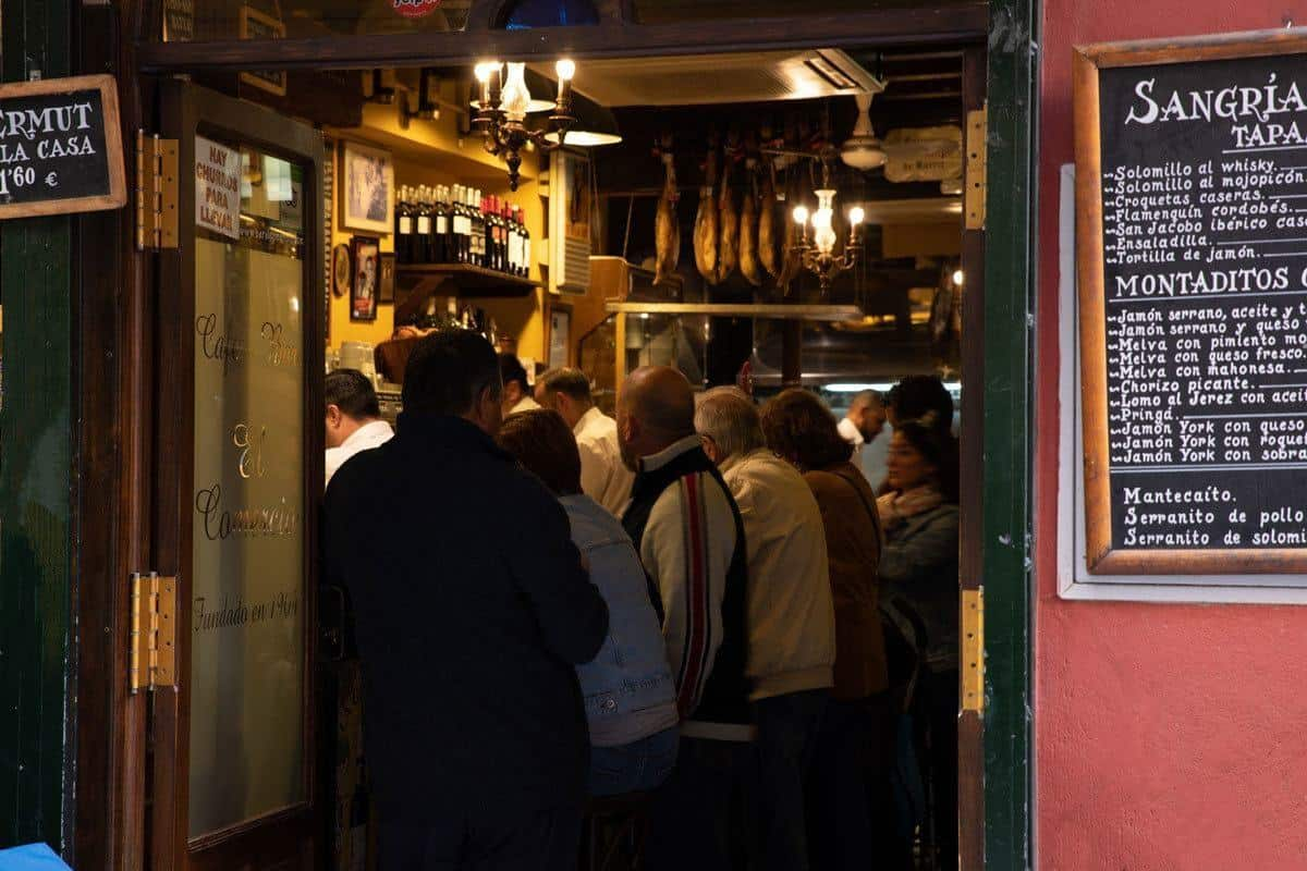 Crowded tapas bar with customers enjoying the best food in Seville, tapas!