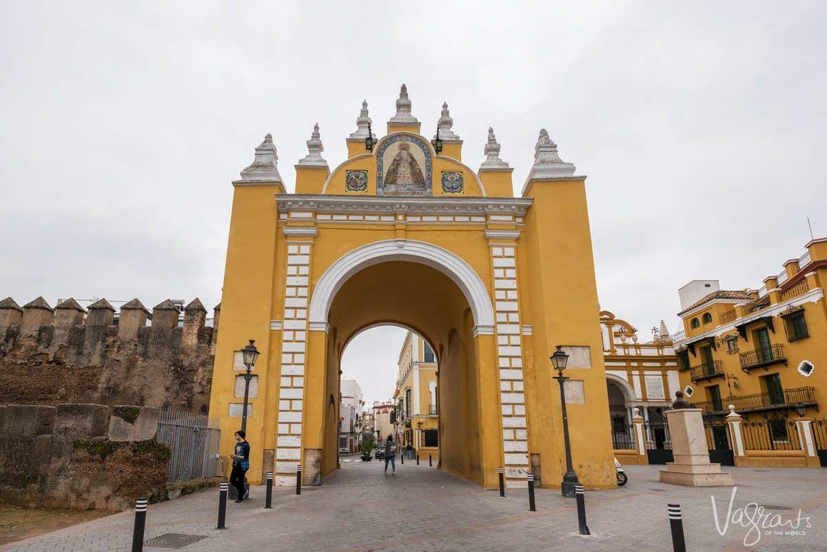 Gold and white arched Macarena Gate Seville.