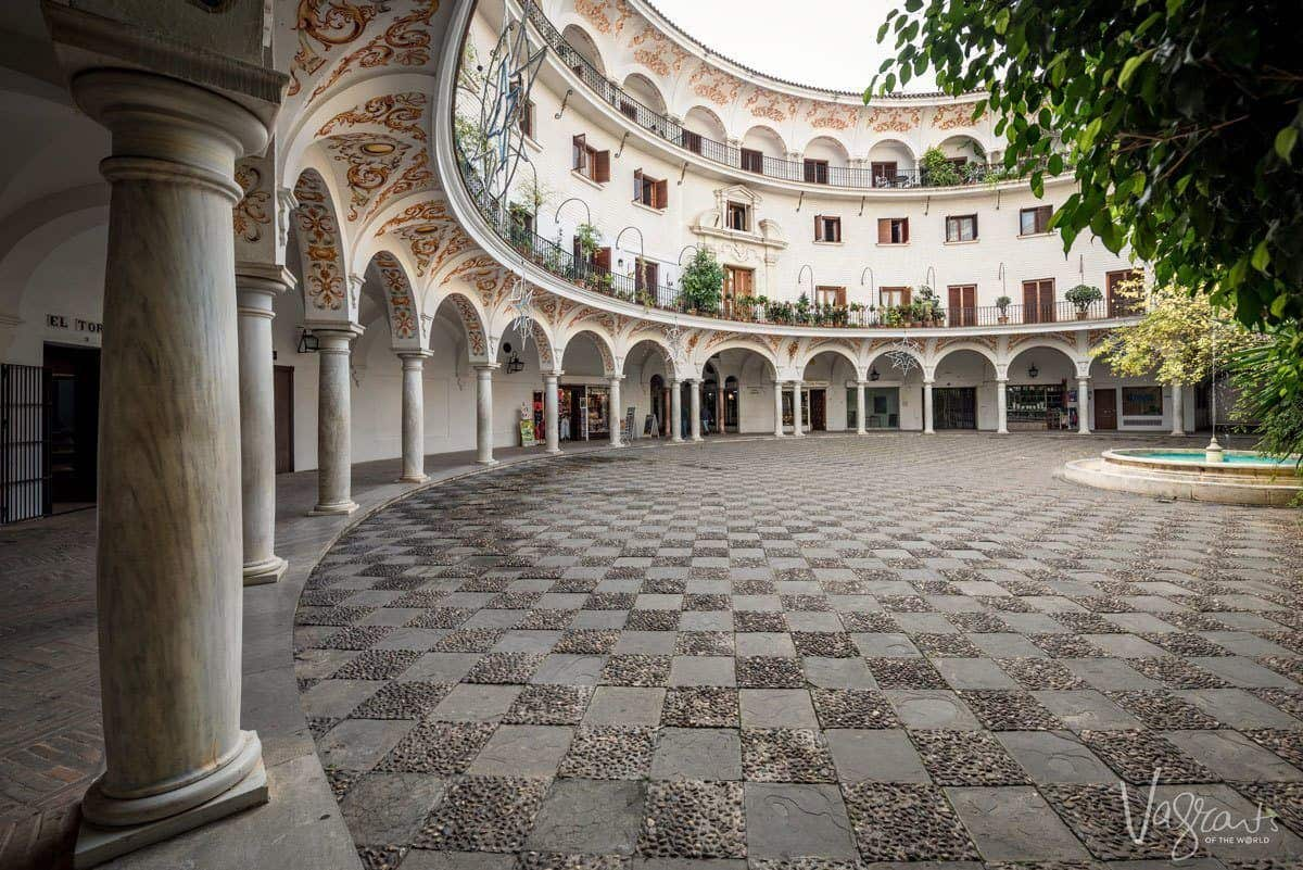 Seville's Round Plaza with chequered courtyard and archways. – Plaza del Cabildo. even if you are in seville on your own or with a seville tour these places are off the beaten track in seville. Bonus they are also free.