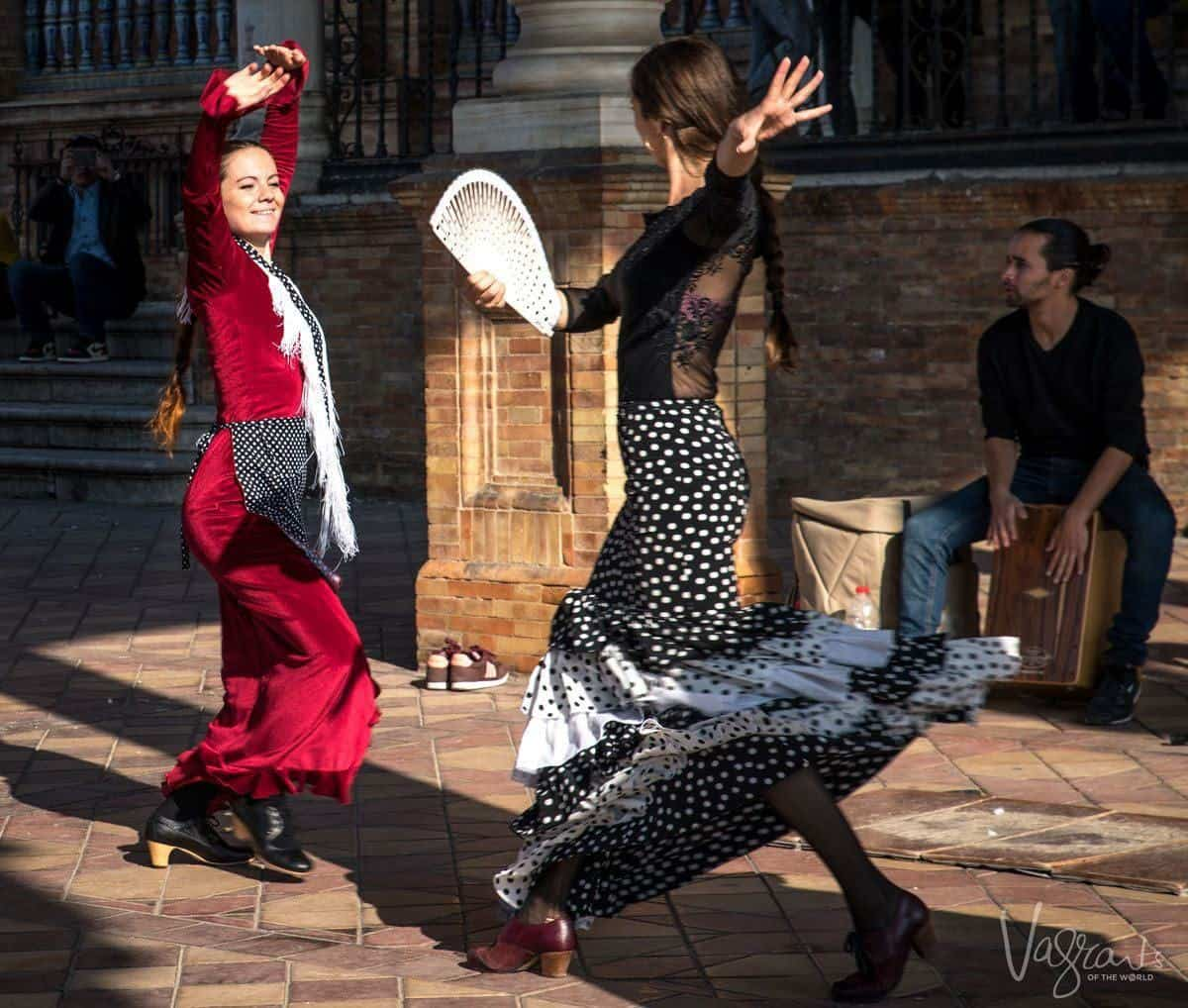 2 girls dancing the Flamenco in Seville Spain.