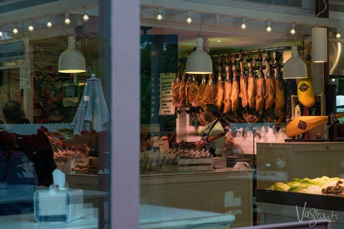Hanging hams in the Market Lonja del Barranco.