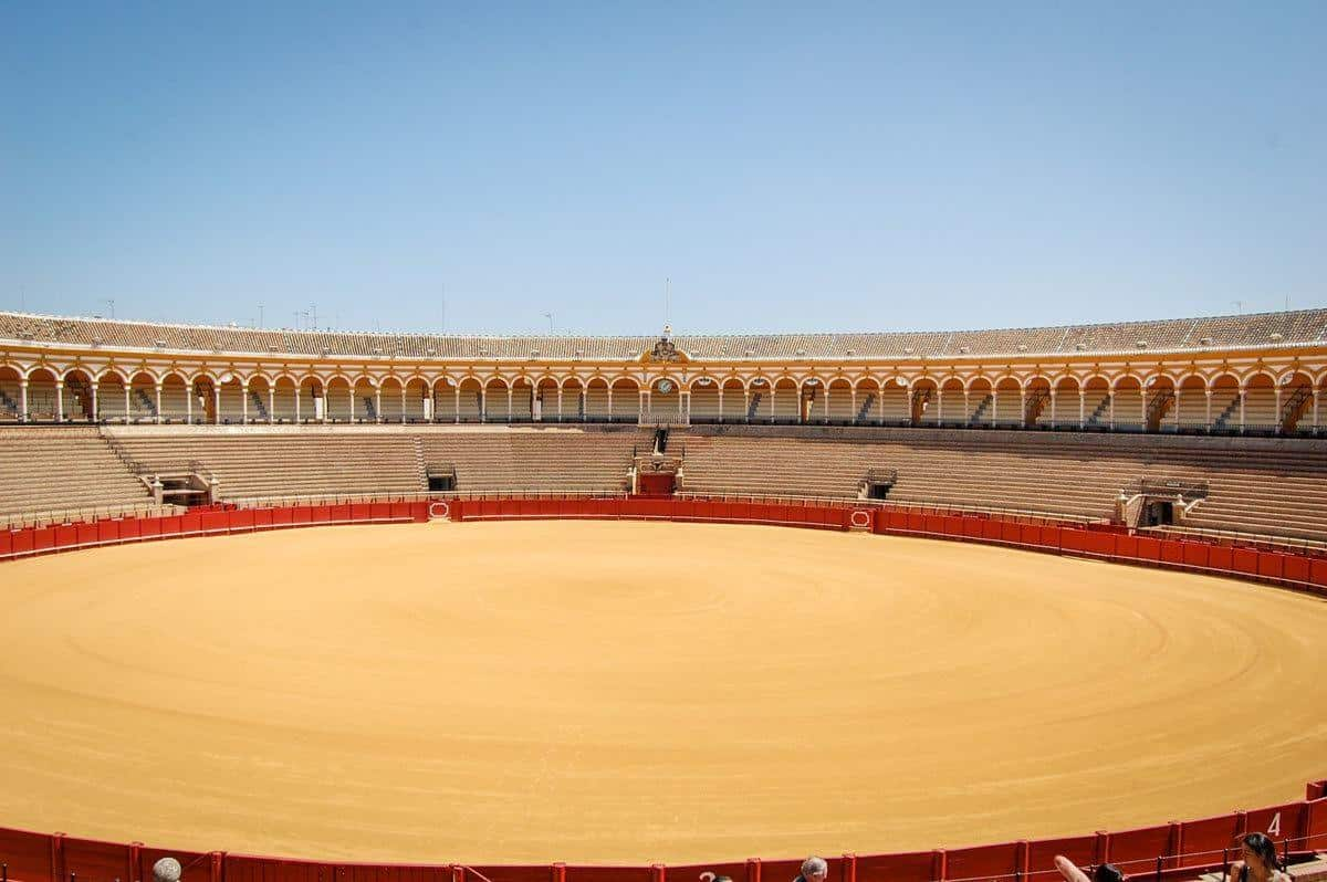 Circular sand bullring and seating at Seville bullring. The bullfighting season in Spain starts in Seville in April.