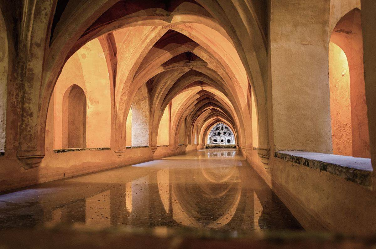 The arches over Baths of María de Padilla - The beautiful cistern under the Royal Alcazar palace. One of the most beautiful things to see in Seville Spain. this may not be unusual thing to do in seville but it is a must on everyones seville itinerary