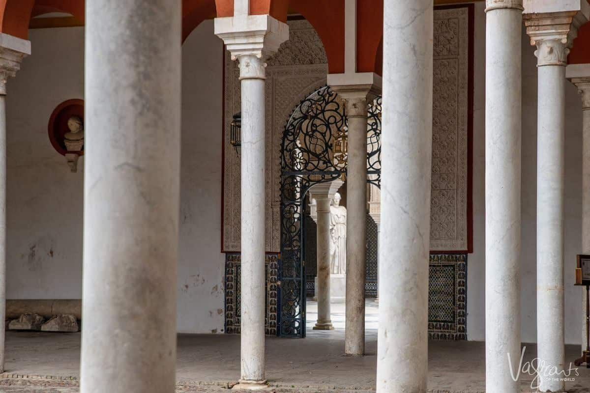 looking through numerous roman marble pillars at Casa de Pilatos Seville. A must on everyones seville itinerary