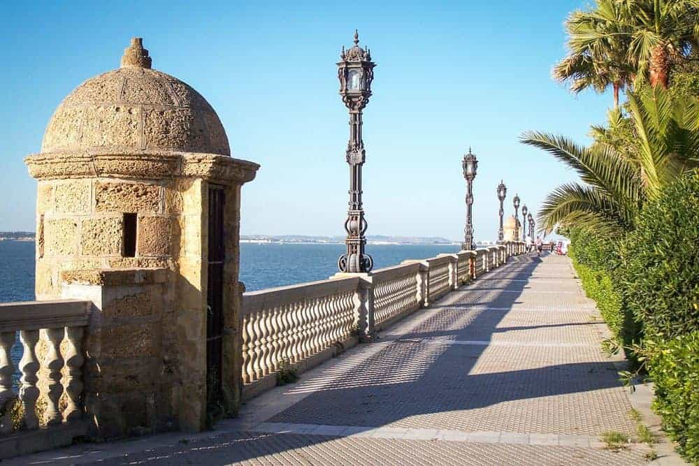 Stone guard house along promenade next to the water in Cadiz. A great free thing to do in Cadiz on your Day trip from Seville to Cadiz