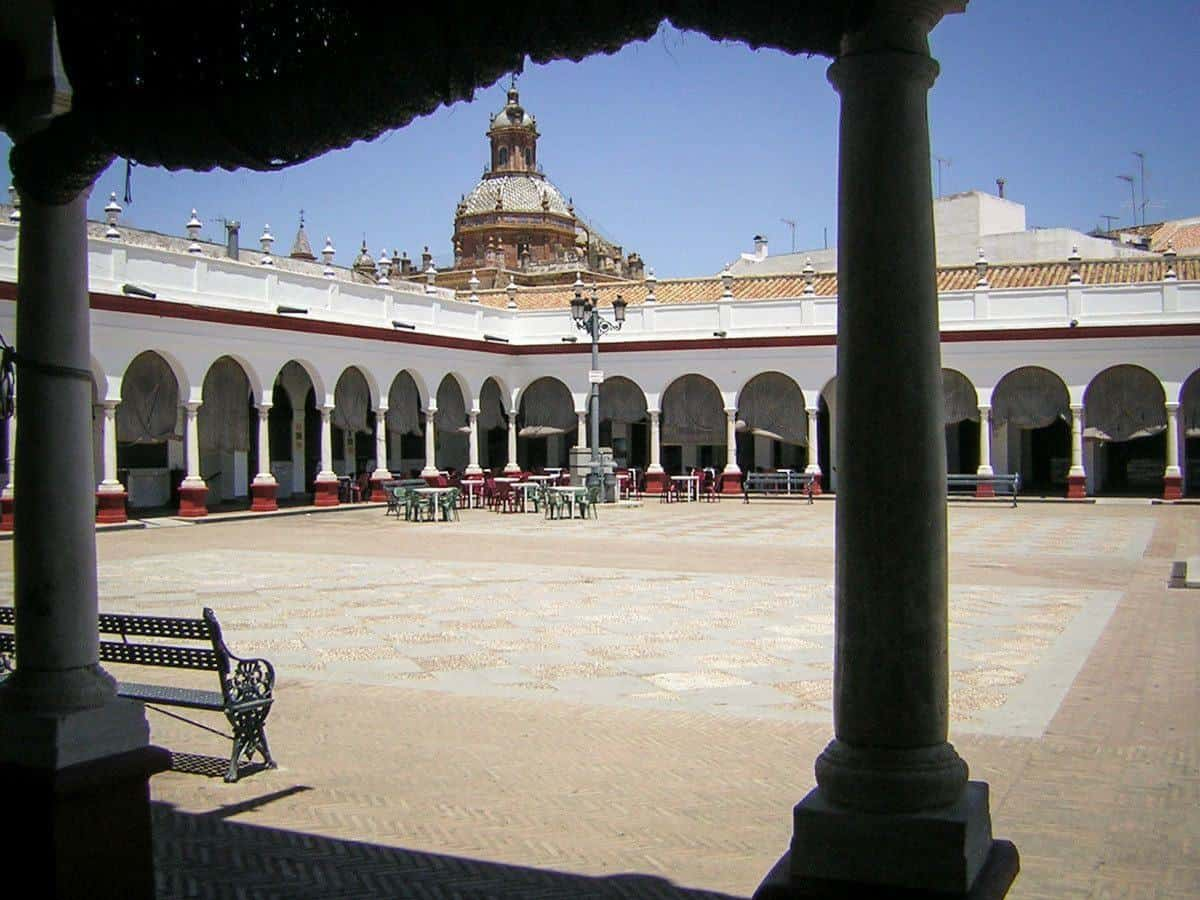 White arches surround this square in Carmona. Looking for things to do in Seville then try a Day trip from Seville to Carmona