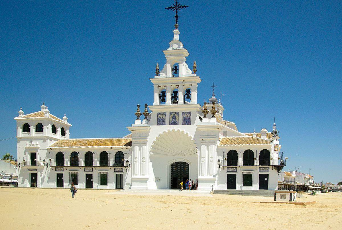 White Cathedral with large black ornate cross. An unusual thing to see on Day Trips from Seville Donana National Park