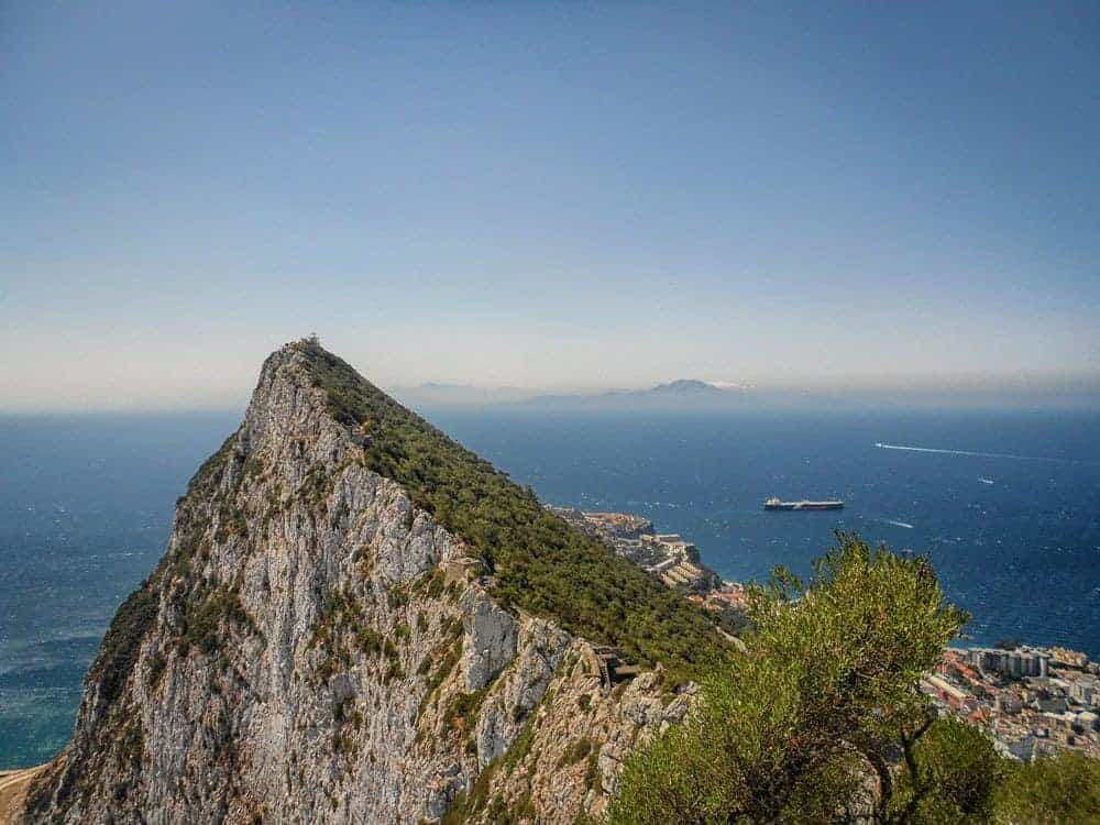 The rock of Gibraltar and ships on ocean. Visit another country on your Day trips from Seville, do Seville to Gibraltar
