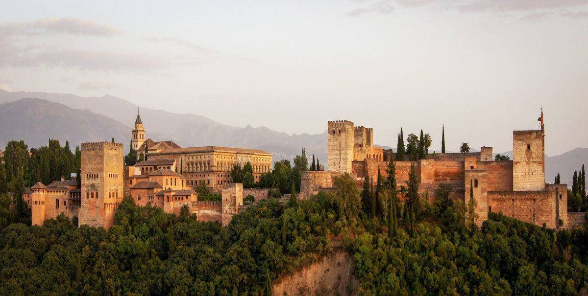 Sunset from afar over Granada. Add this to your Seville itinerary as the best Day Trips from Seville to Granada