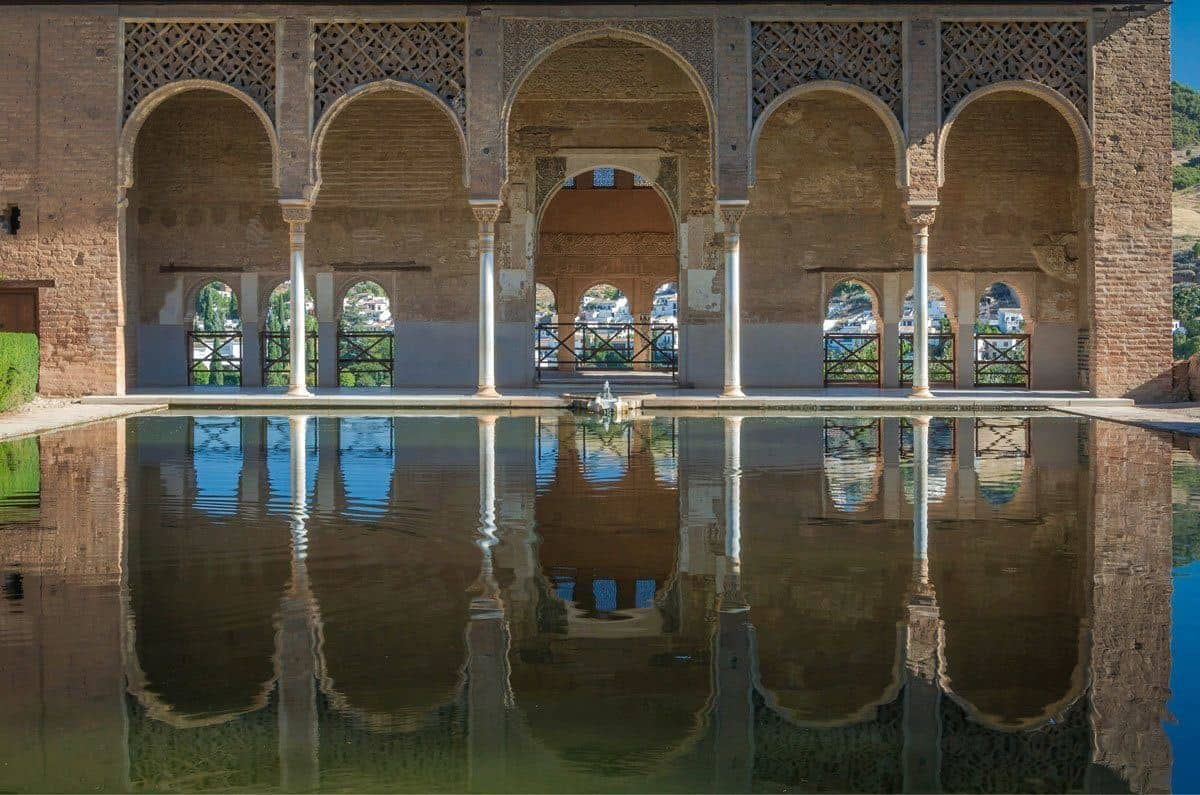 Arches reflected in pond in Granada, visiting here is one of the best free thing to do in Grananda. It is worth taking Day Trips from Seville to Granada