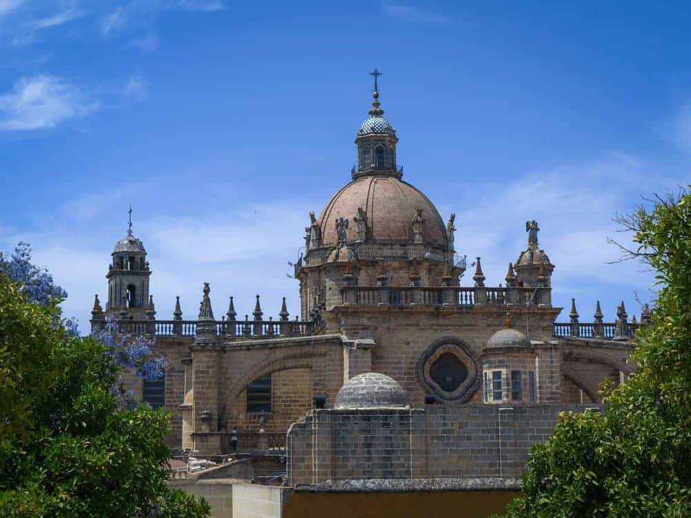 Jerez church with small statues around steeple. A must see on Day trips from Seville to Jerez